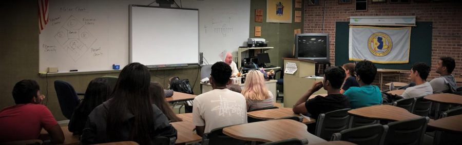 The+class+is+attentive++while+Mr.Brodman+explains+a+trip+the+the+Constitution+Center.