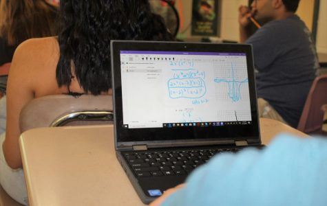 A student completes the daily activity on his new Lenovo Thinkpad