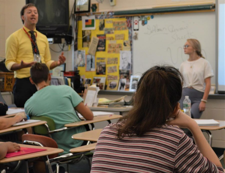 Students listen intently as Mr. Wildermuth works with the class presenter to explain new information about the brain.