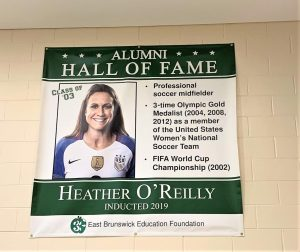 Heather O'Reilly's poster is one of the first to be hung. Read her poster to find out all about her.