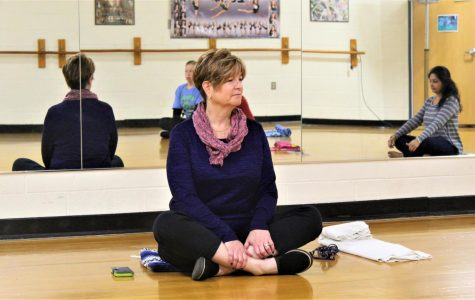 "EBHS teacher, Mrs. Santoriello, shares ""the gift  of breathing"" under the lights of the dance room before the start of school on Wednesday. She guides the meditation session focusing on the gifts we give to ourselves, even as simple as ""allowing your next breath the be a deep one."""