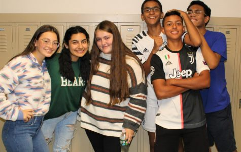 Various members of Student Council get together to film a short video, creatively showcasing all the interesting themes the upcoming spirit week has to offer. While hard at work promoting the event, the team of students never ceased to have fun in the process; as seen in the photo, they remain positive and bonded by their dedication to EBHS.  (Left to Right - Jackie Gerace, 11; Joy Elasmar, 12; Audrey Shelley, 12; Ahmed El Shamma, 11; Marco Landeo, 11; Isaiah Almero, 12.)