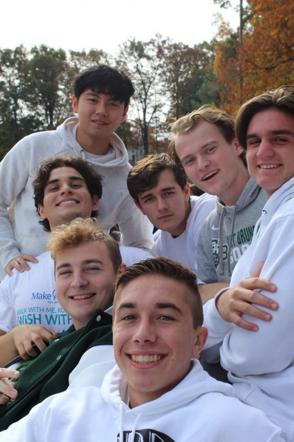 Seven seniors, all dressed in EBHS apparel and spirit wear, happily pose for a picture.