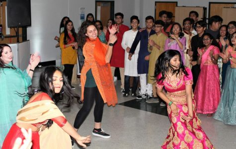 Ms. Schenk and Ms. Shanks along with two students perform a traditional Bollywood dance.