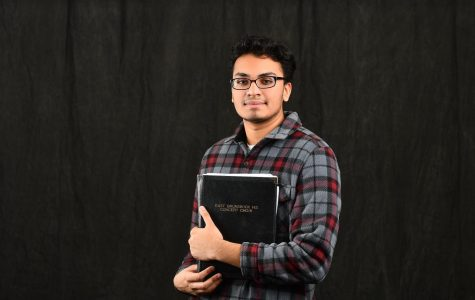 Kevin Niranjan posing with his choir folder.