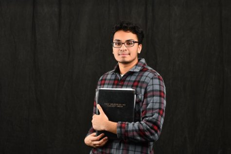 Kevin Niranjan posing with his choir folder.