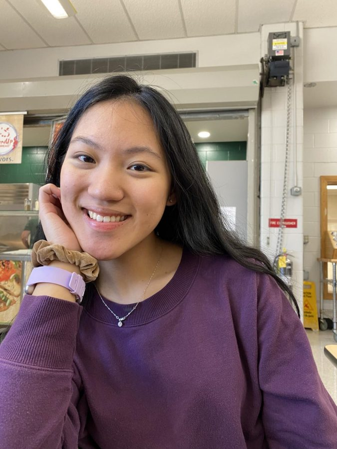 Senior Leah Chin smiles for the camera with her scrunchie.