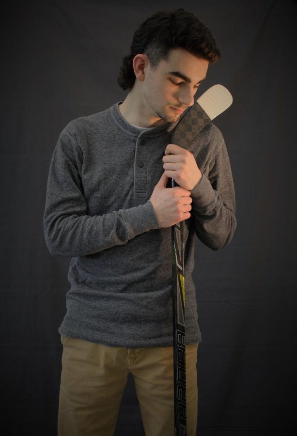 Jack Krawet, 12, dramatically shows his passion for hockey, hugging his stick with a tight grasp.