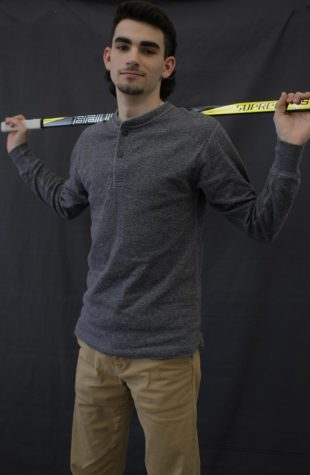 Jack Krawet, 12, stands tall with his hockey stick over his shoulders.