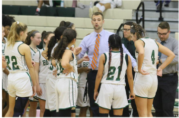 Coach Retz prepares his girls for the game; encouraging them to try their best and play as a team.