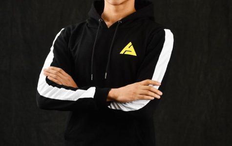 Malcolm Linnehan-Herring, student entrepreneur, is dressed up head-to-toe in his clothing brand, Atlas Innovative