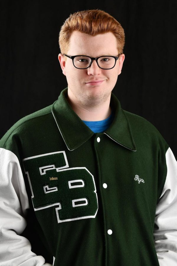 Ryan Murray poses for a photo in his Basketball varsity jacket.