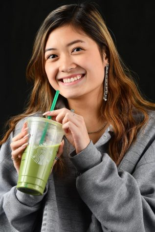 Kylie Luk, 12, sips her Starbucks Iced Matcha Latte with a smile.