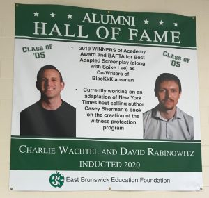 A poster honoring screenwriters Charlie Wachtel and David Rabinowitz hangs in the EBHS terminal.