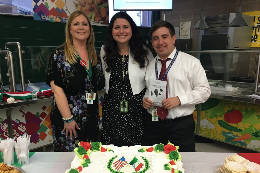 A photo of the districts' three Italian teachers at the induction ceremony for Italian Honors Society last year. Mrs. Bonelli (left) teaches at Hammarskjold, Mrs. Spagnuolo (middle) teaches at the high school, and Mr. Keenan (right) teaches at Churchill.