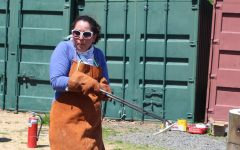 Ms. Hanania wields a wicked-looking tool to grab onto items after being fired in Ceramics.