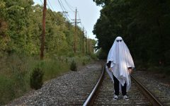 Spooky! Adrian Sorice, 11, spruces up his ghost costume with some snazzy shades and poses on the tracks to capture this Folio submission. Photo credits to him and his timed-camera!