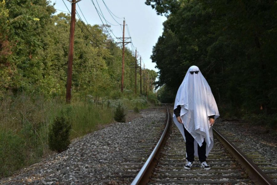 Spooky%21+Adrian+Sorice%2C+11%2C+spruces+up+his+ghost+costume+with+some+snazzy+shades+and+poses+on+the+tracks+to+capture+this+Folio+submission.+Photo+credits+to+him+and+his+timed-camera%21