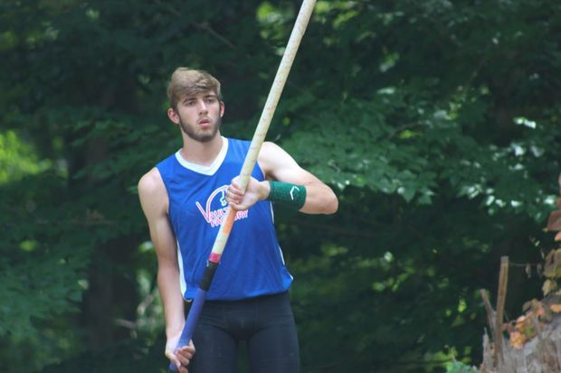 Brian Mcsweeney, Senior, stares down the runway at one of the few summer pole vaulting meets.