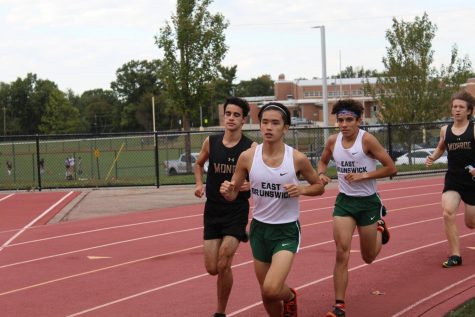 Captains Matthew Gonzalez, 12, and Matthew Tiongko, 12, lead the team as they race through the EBHS course. This meet, on October 1 against Monroe, was the season