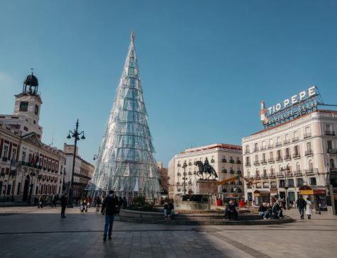 Puerta del Sol, with a Christmas tree in the background, is a calm public square. On New Year