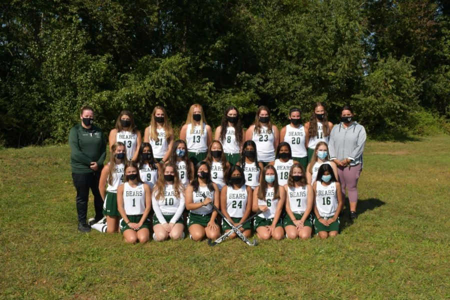 Coaches Gnatt and Mcquade pose with the varsity field hockey team on picture day. COVID-19 may have affected their season, but it's only made their connection as a team stronger.