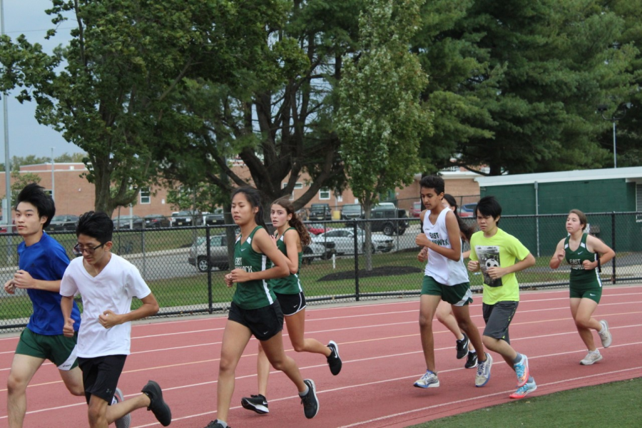 Lena Park, 12, and Ariana D'Onofrio, 10, are seen running at a home meet.