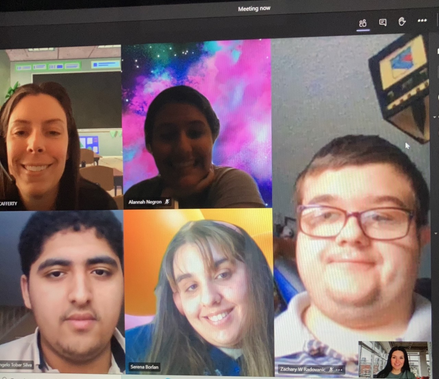"""Ms. Cafferty along with an assembly of some of her students. """"The way your mind is wired won't stop you from making your dreams come true!"""" says Serena Borlan, 12, ecstatic about the project."""