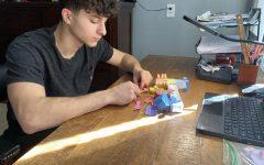 Joshua Platzman, 12, works on a DIY lab.