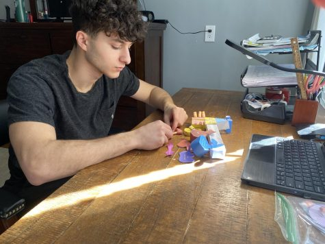 Joshua Platzman, 12, works on a DIY lab.