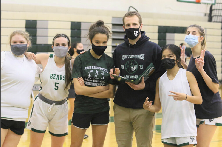 Coach+Retz+and+his+senior+players+%28+Laren+Hannan%2C+Minta+Cuane%2C+Sophia+Jorgenson%2C+Erin+Cosio%29%2C+and+junior+Sophia+Winston%2C+prepare+for+their+upcoming+game+with+a+serious+determination+to+make+this+season+the+best+we%E2%80%99ve+seen..+