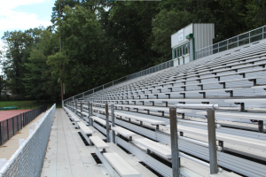 The bleachers at Jay Doyle Field remain barren in the aftermath of recent summer rainstorms.