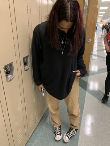 Senior Natalie Del Rosario checks out her cute and cozy outfit.