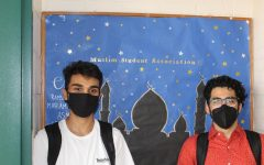 Saad and Shaheer, board memebrs of MSA  hang up their poster hoping to recruit new members.