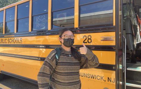 Sophomore Nichole Gonzales gets ready to board her bus in the afternoon. She looks forward to listening to music and talking with friends on the ride home.