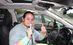 A photo of a senior in her car