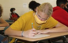 Student Completing a Test on Paper