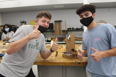 Zach Driscoll (12) and Thomas Jaycard (12) work on their project in Capstone Engineering, hoping the light will show up in their box.