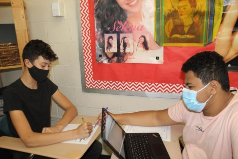 Marco Fouad 10, helping his classmate Brandon Silvera 10 on Franscics idioms assignment